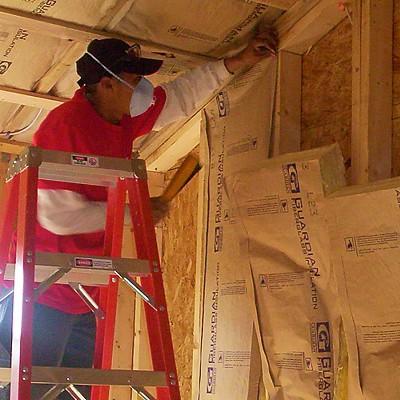 Fibergl Batt Insulation Batts Being Installed