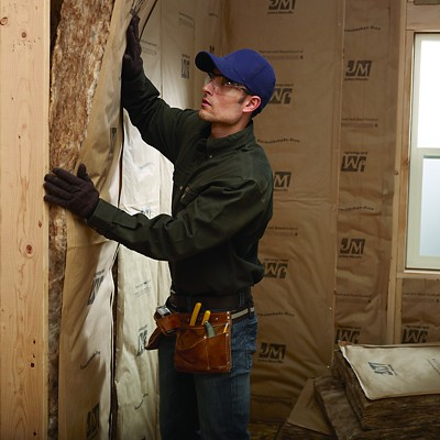 Installer with Johns Manville Insulation